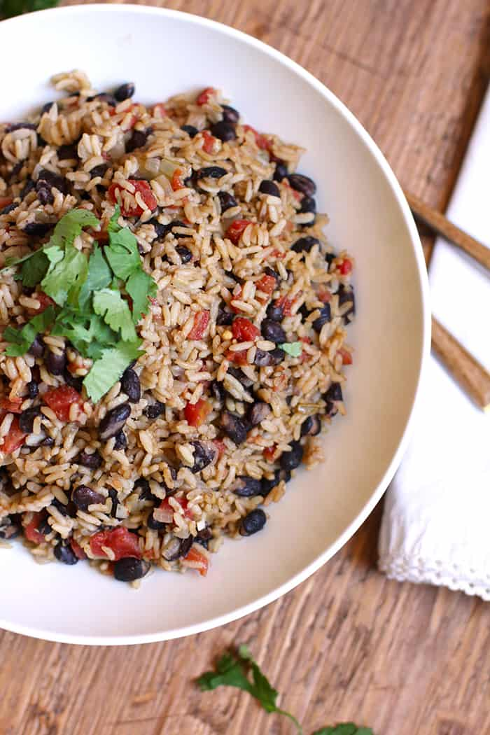 Spanish Rice with Beans is the perfect side dish for any Mexican Fiesta, or for a simple chicken dinner. The HOT Rotel adds a spicy kick, but not overpowering! | suebeehomemaker.com