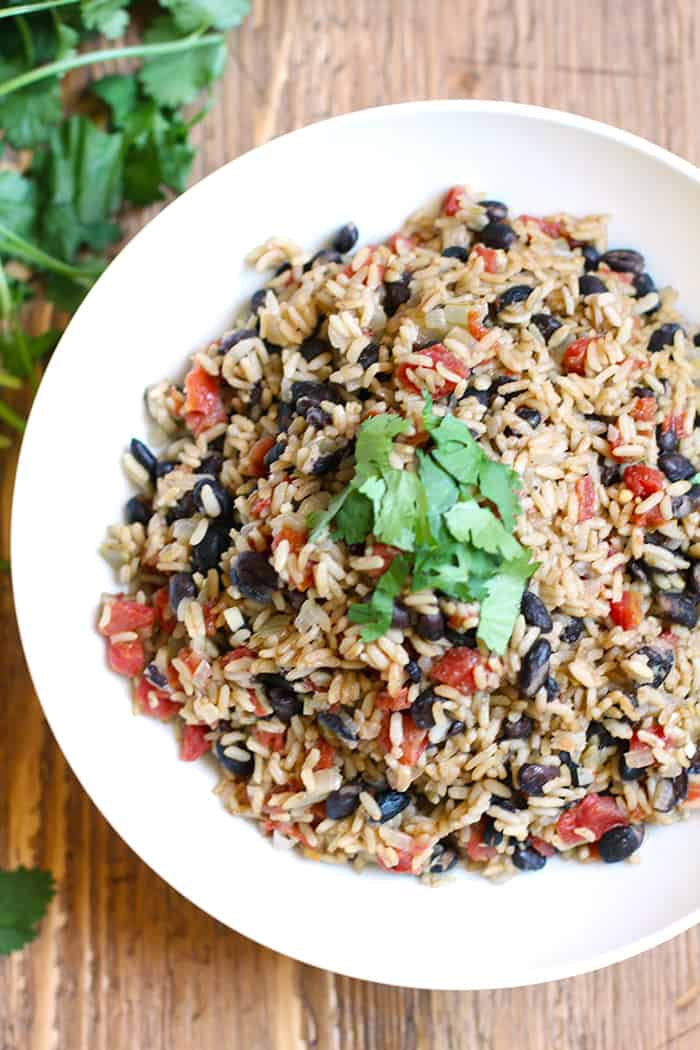 Spanish Rice with Beans is the perfect side dish for any Mexican Fiesta, or for a simple chicken dinner. The HOT Rotel adds a spicy kick, but not overpowering!   suebeehomemaker.com