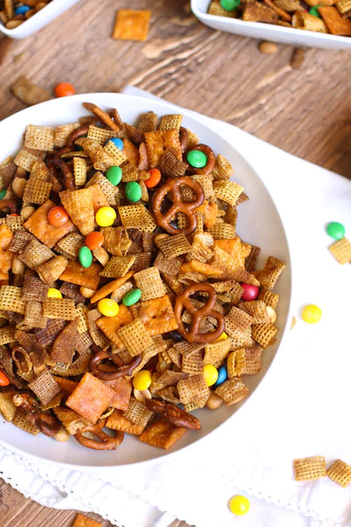 Spicy Chex Party Mix is a spin on the classic Chex mix, with the addition of a big hit of hot sauce! Watch out because this is totally addicting! | suebeehomemaker.com