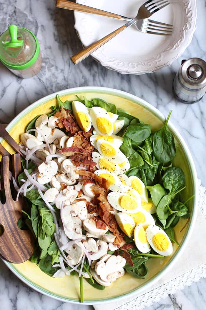 Spinach Salad with Honey Dijon Dressing is easy to prepare, hearty enough for the biggest appetite, and the tangy dressing adds an extra punch of flavor!   suebeehomemaker.com
