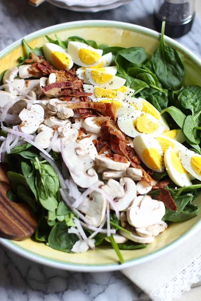 Spinach Salad with Honey Dijon Dressing is easy to prepare, hearty enough for the biggest appetite, and the tangy dressing adds an extra punch of flavor! | suebeehomemaker.com