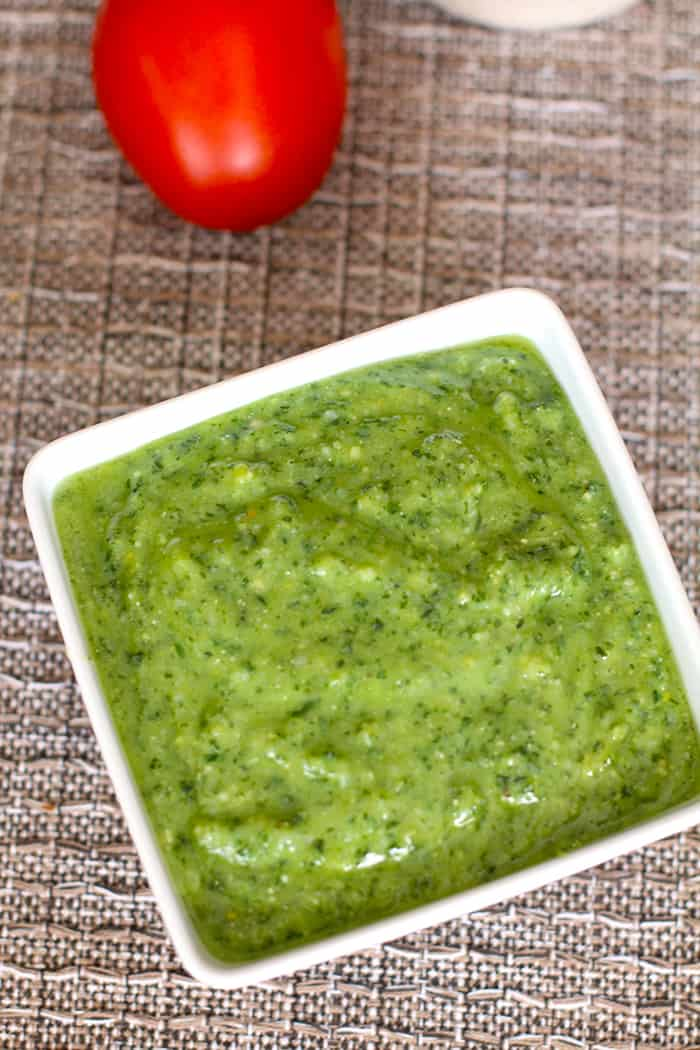 Homemade Pesto Sauce -- a delicious sauce, using fresh basil, parmesan cheese, garlic, toasted pine nuts, salt and pepper, and olive oil. Freezes well too! | suebeehomemaker.com