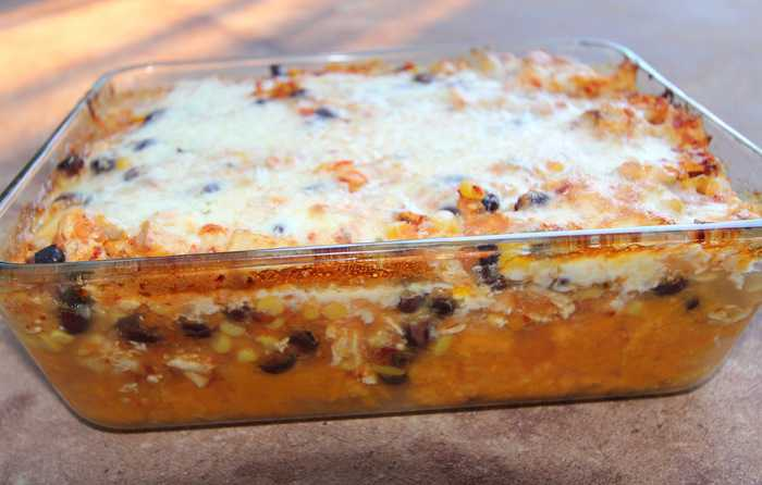 Spicy Chicken and Sweet Potato Casserole -- a delicious layered casserole of mashed sweet potatoes, chicken, black beans, and corn, with a spicy chipotle sauce topped with Mexican cheese! | suebeehomemaker.com
