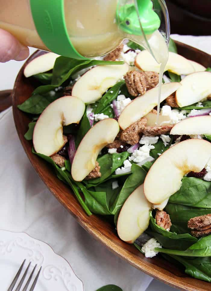 Candied Pecan and Apple Holiday Salad -- a delicious Holiday Salad with fresh greens, candied pecans, Honey Crisp apples, feta cheese, and Raisins! | suebeehomemaker.com