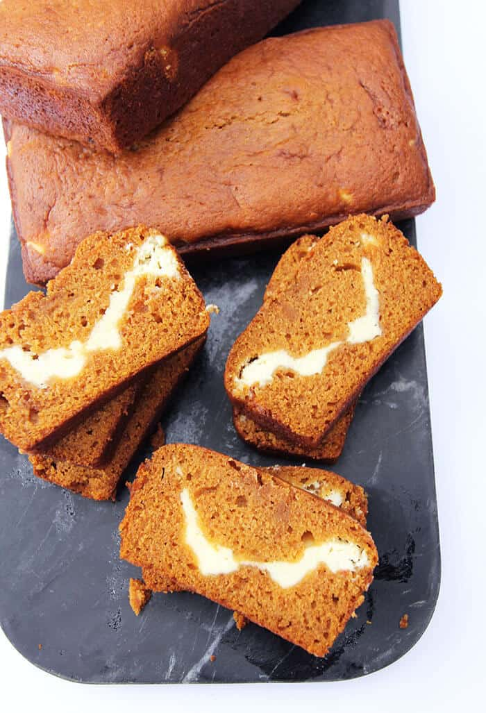 Pumpkin Cream Cheese Bread -- a moist pumpkin bread with a cream cheese layer in the center! | suebeehomemaker.com