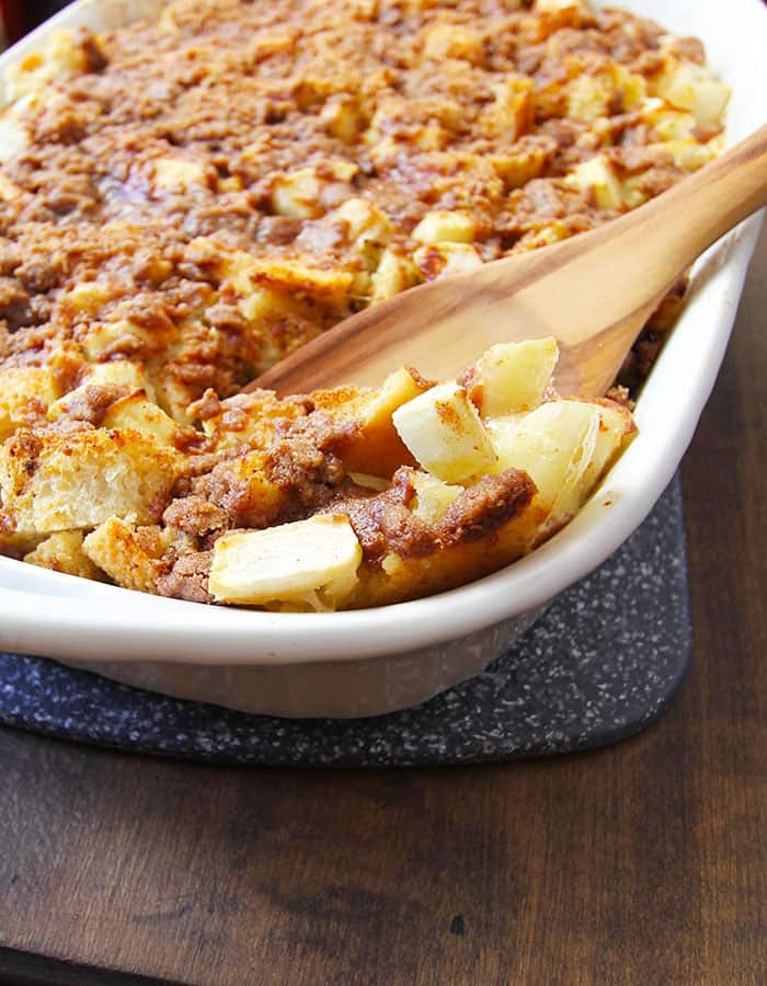 Overnight Cinnamon Apple French Toast Bake -- a delicious casserole of french toast with apples, topped with a butter/sugar combo for crunch! | suebeehomemaker.com