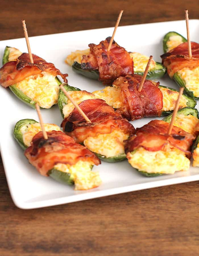 Bacon-Wrapped Jalapeno Poppers -- a cheesy, cream cheese filled jalapeño wrapped in bacon! | suebeehomemaker.com
