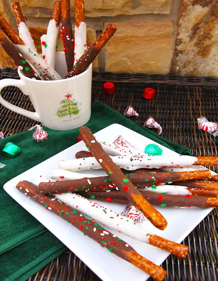 Chocolate Covered Pretzels -- a simple recipe using pretzel rods dipped in chocolate with sprinkles on top! | suebeehomemaker.com