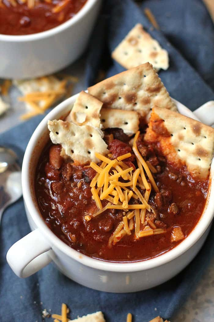 A hearty and slightly spicy chili full of beans, ground beef, onions, tomatoes, and jalapeños. Perfect to slow cook all day long on a cold winter day! | suebeehomemaker.com