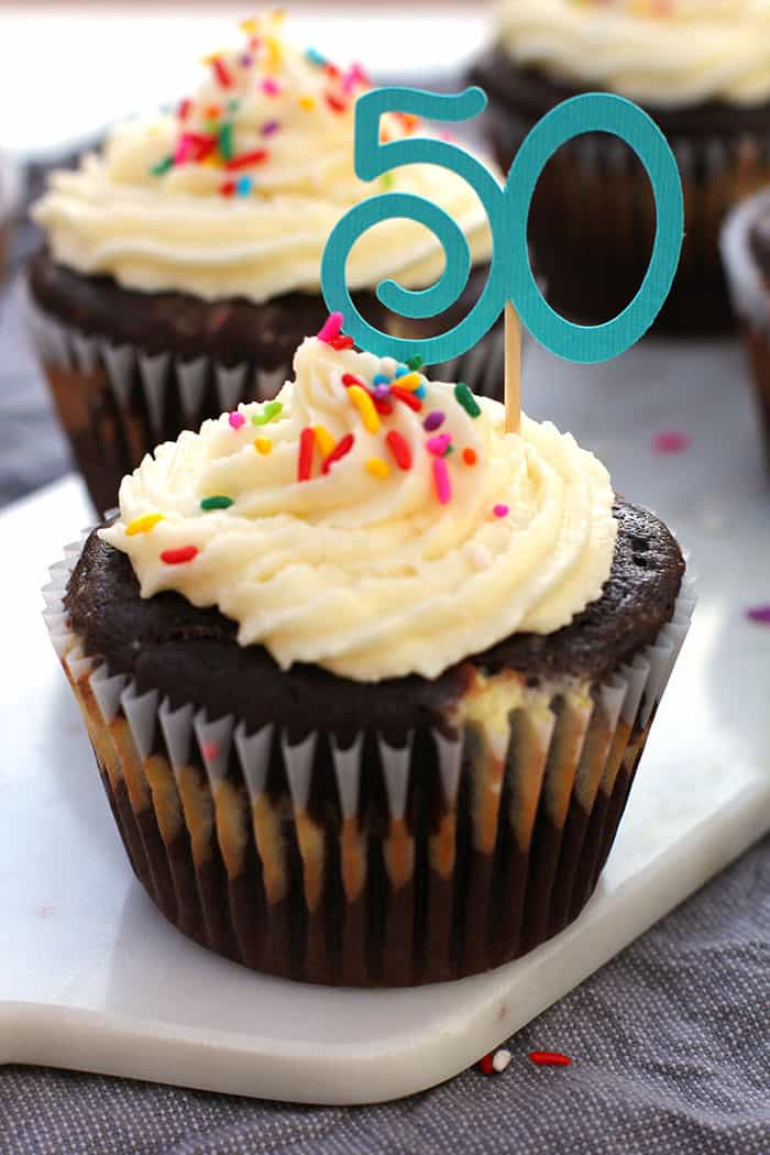 Jumbo Chocolate Birthday Cupcakes -- a decadent chocolate cupcake, with a cream cheese and chocolate chip filling and buttercream frosting! -- suebeehomemaker.com