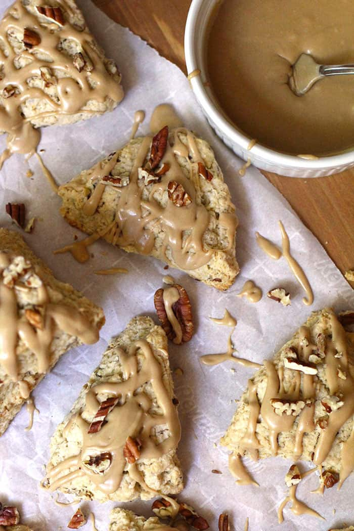 Maple Oat Pecan Scones are a perfect sweet treat with a cup of coffee. Using cold butter helps to form buttery pockets in every bite. So simple to make! | suebeehomemaker.com