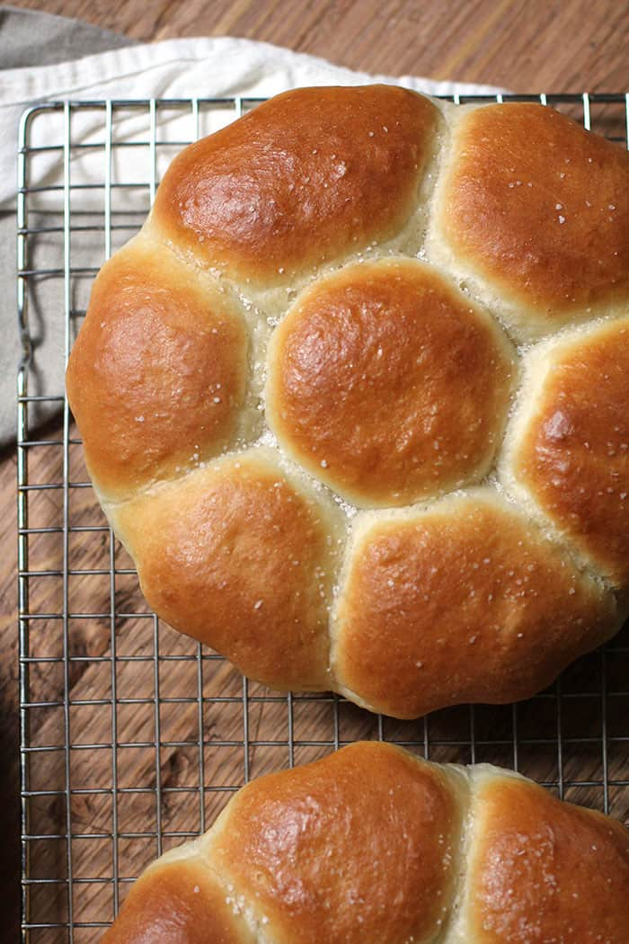 Mom's dinner rolls on a cooling rack over a wood background.
