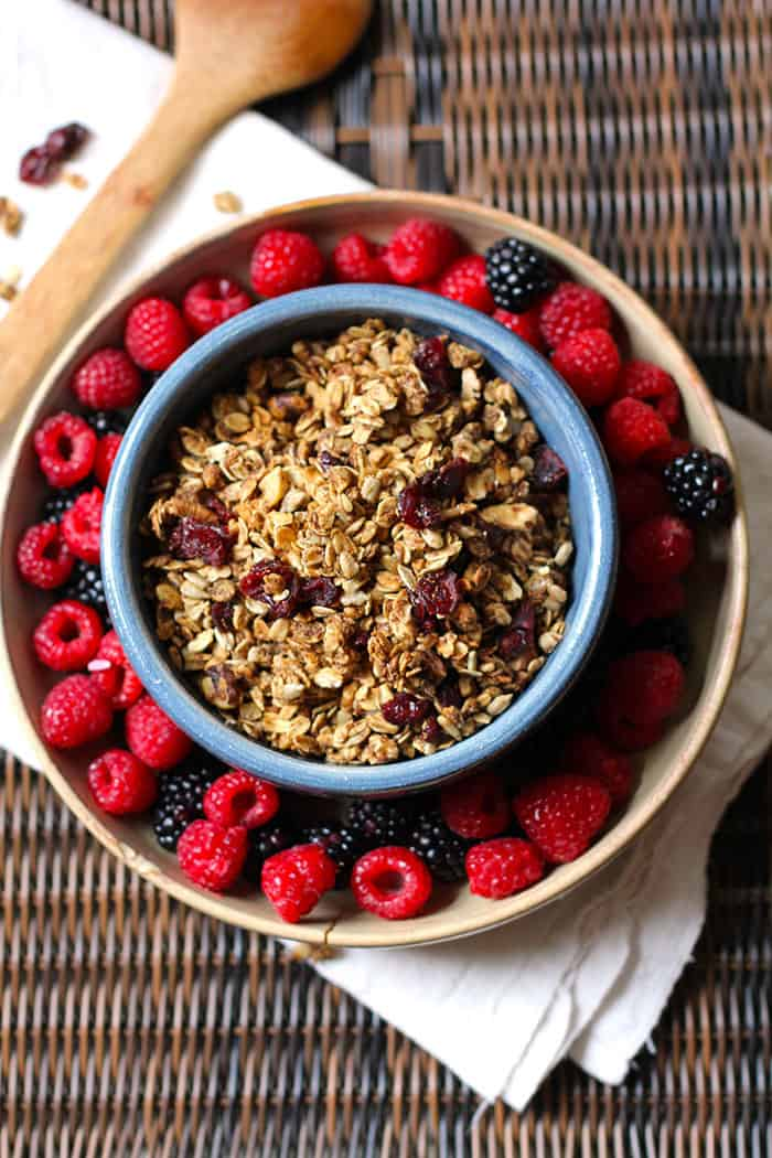 Cinnamon Nut Granola -- a crunchy cinnamon granola loaded with nuts, oats, pumpkin seeds, and dried cranberries! | suebeehomemaker.com