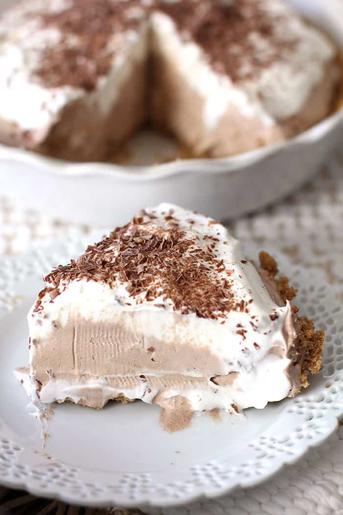 French Silk Pie is creamy and chocolatey, with a graham cracker crust base, a chocolate filling, topped with whipping cream and shaved chocolate! -- suebeehomemaker.com