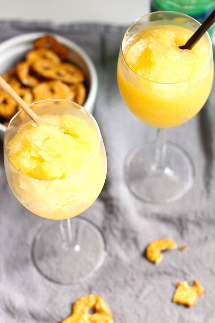 Fresh fruit, white dessert wine and sugar makes the best wine slushies ever. Easy to make at home. Great wine slushy sorbet drink for summer cocktails.