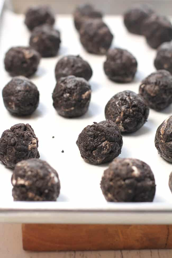 Side shot of a baking sheet of Oreo Truffles, before the white chocolate is added.