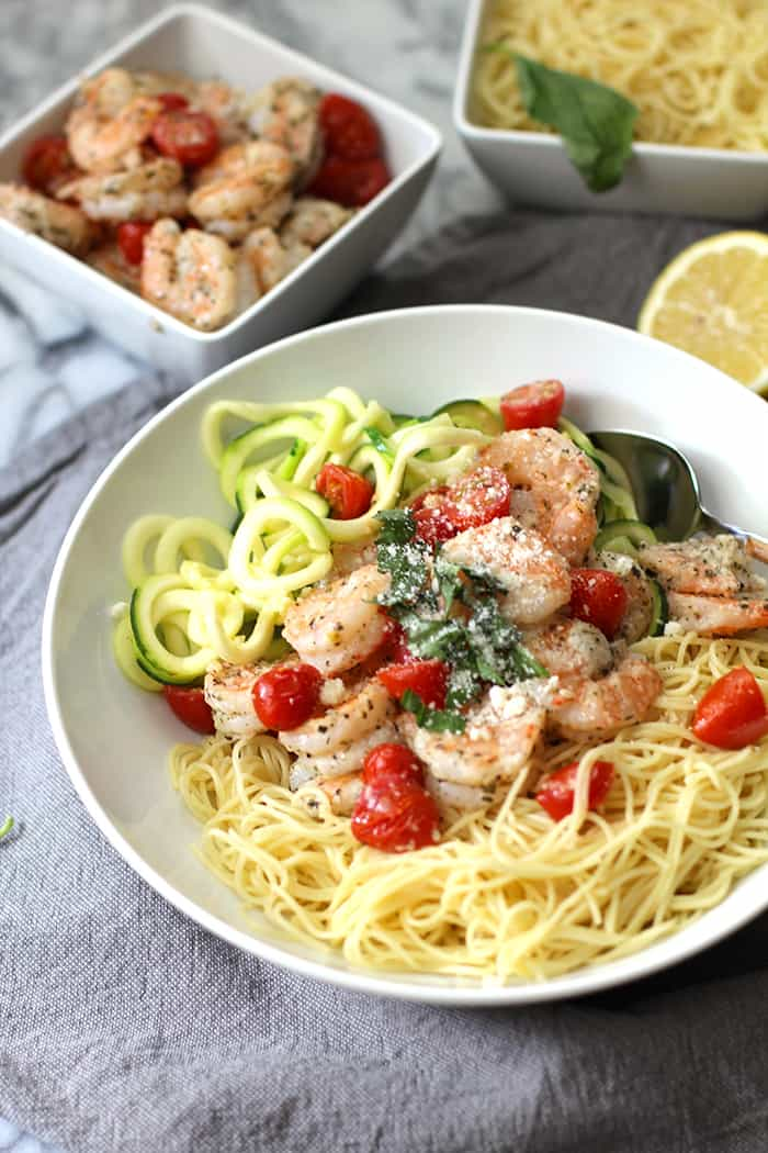 "Baked Parmesan Shrimp Bowls are ""healthified"" as the shrimp are baked, not fried, and zucchini noodles are subbed in for half of the pasta noodles! 
