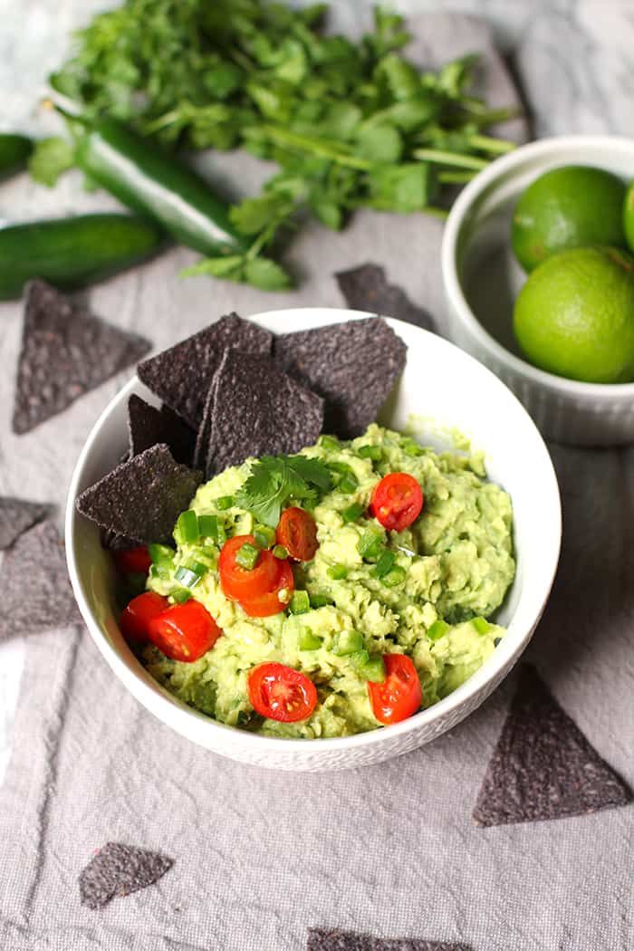 Chunky Guacamole is a super easy 6-ingredient appetizer, made with avocados, jalapeño, freshly squeezed lime juice, garlic salt, tomatoes, and cilantro. | suebeehomemaker.com