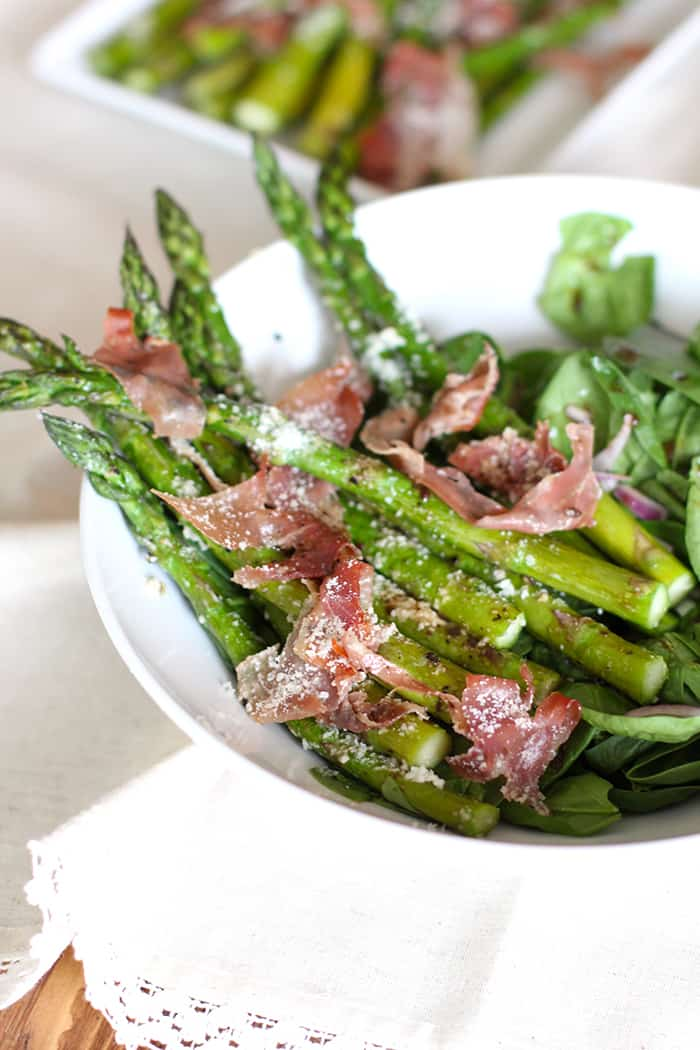 Roasted Asparagus is a go-to side dish in my kitchen. Adding some prosciutto and parmesan takes this dish to another level! | suebeehomemaker.com