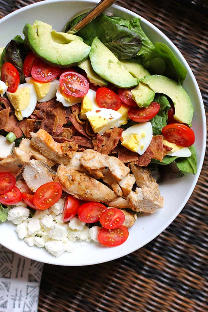 This Grilled Chicken Cobb Salad is a hearty and satisfying main dish salad, with plenty of proteins and good fats. Top it off with a delicious apple cider vinaigrette! | suebeehomemaker.com