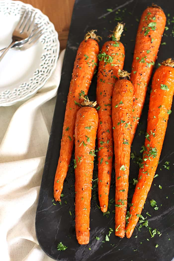Honey Roasted Carrots are a simple side dish, combining carrots with olive oil and honey, salt and pepper, and fresh parsley! | suebeehomemaker.com