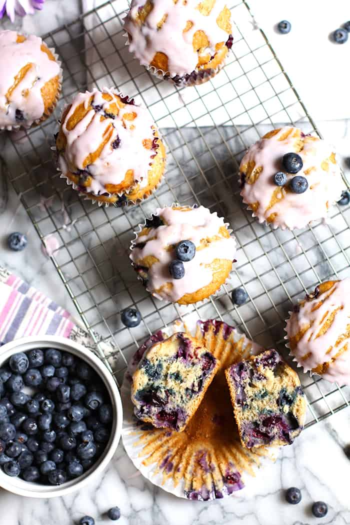 Yogurt Glazed Blueberry Muffins boast two cups of fresh blueberries, along with a sweet glaze made with real blueberry yogurt! | suebeehomemaker