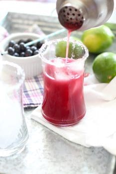 Fresh blueberries, freshly squeezed limes, quality tequila and orange liqueur, and lots of ice - makes up these super simple, belly-slimming, Blueberry Lime Margaritas! | suebeehomemaker.com