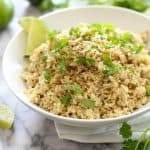 Cilantro Lime Rice makes a perfect Tex-Mex side, combining long grain brown rice with onions, garlic, cumin, cilantro, and freshly squeezed lime juice! | suebeehomemaker.com