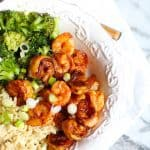 This Easy Honey Sriracha Shrimp combines a sweet and spicy marinade with tender shrimp. Eat it plain or serve it over rice and your favorite vegetables! | suebeehomemaker.com