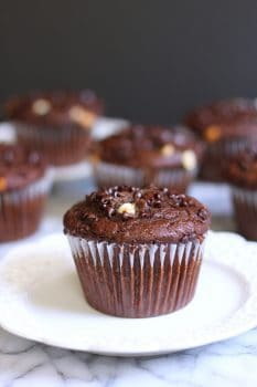Jumbo Chocolate Banana Wheat Muffins are made with wholesome ingredients, like honey, applesauce, bananas, white whole-wheat flour, and flaxseed meal! | suebeehomemaker.com