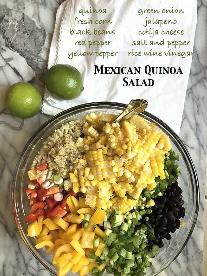 Mexican Quinoa Salad is protein packed, with two cups of quinoa, black beans, peppers, jalapeños, green onions, fresh corn, and Cotija cheese! | suebeehomemaker.com