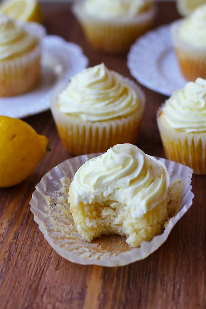Perfect Lemon Cupcakes are incredibly moist and bursting with freshly squeezed lemon juice and zest. The buttercream frosting has even MORE lemons! | suebeehomemaker.com