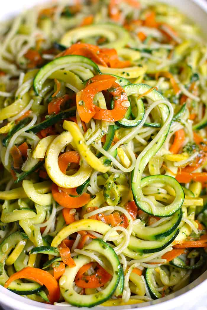 Close-up of a heap of vegetable pesto pasta.