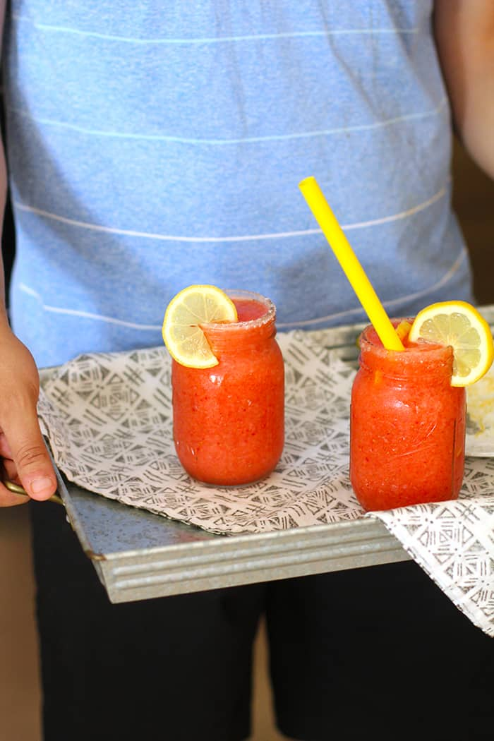 Fresh strawberries and lemons, combined with vodka, ice, and a little bit of sugar make these Strawberry Lemonade Vodka Slushies the hit of the party! | suebeehomemaker.com