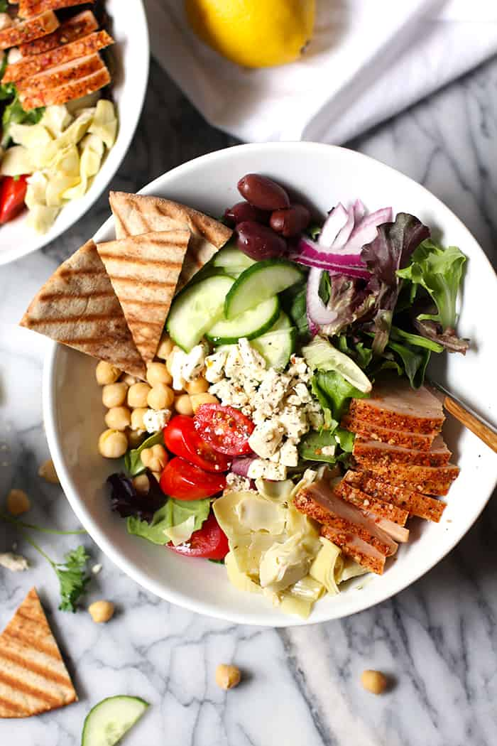 Overhead view of a bowl of traditional Greek Salad with smoked turkey