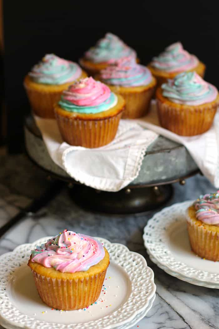 Vanilla Unicorn Cupcakes are modeled after the current trending Starbucks Unicorn Frapp. A perfect vanilla cupcake with a colorful buttercream frosting!   suebeehomemaker.com