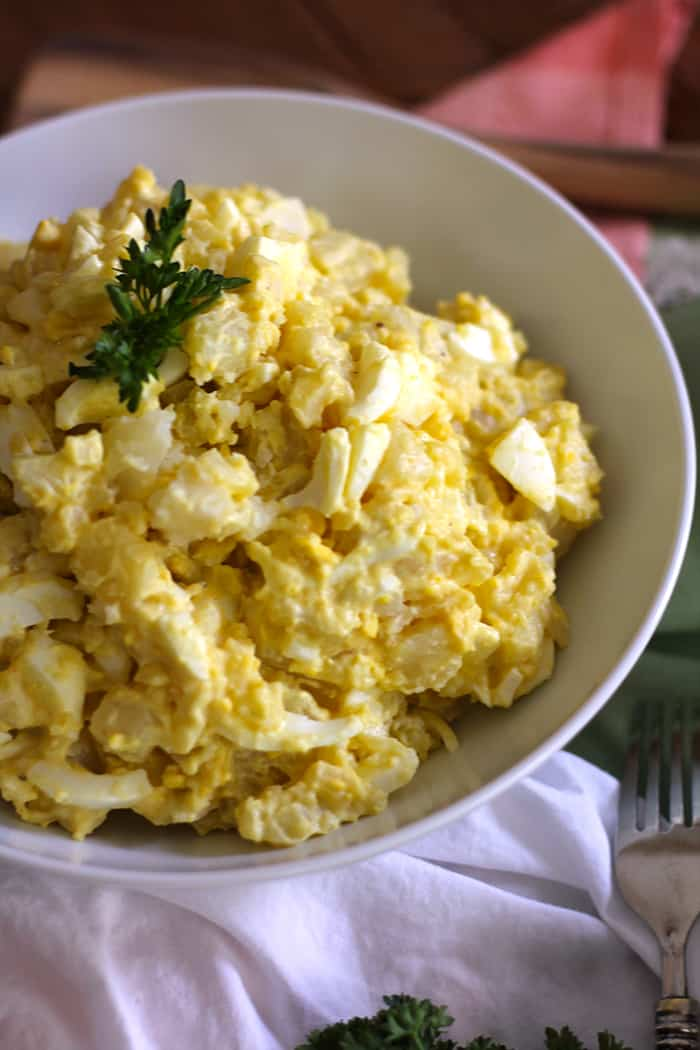 Creamy Potato Salad combines potatoes and egg white slices with a dressing, consisting of mashed egg yolks, Miracle Whip, vinegar, sugar, and half & half! | suebeehomemaker.com