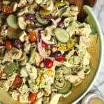Greek Tortellini Pasta Salad combines cheese-filled tortellini with garbanzo beans, feta cheese, olives, lots of veggies, and a fresh greek vinaigrette! | suebeehomemaker.com