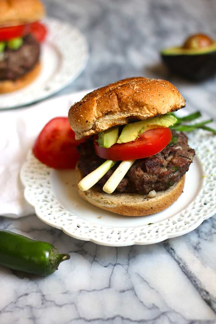 Spicy Jalapeño Burgers combine ground sirloin with diced onions, bell peppers, and jalapeño peppers, making these moist and moderately spicy! | suebeehomemaker.com