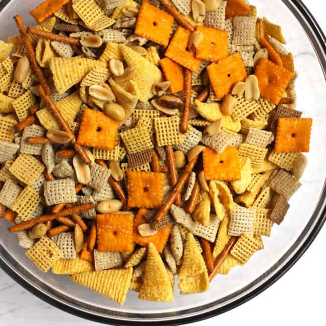 Overhead shot of a glass bowl of Chex party mix.
