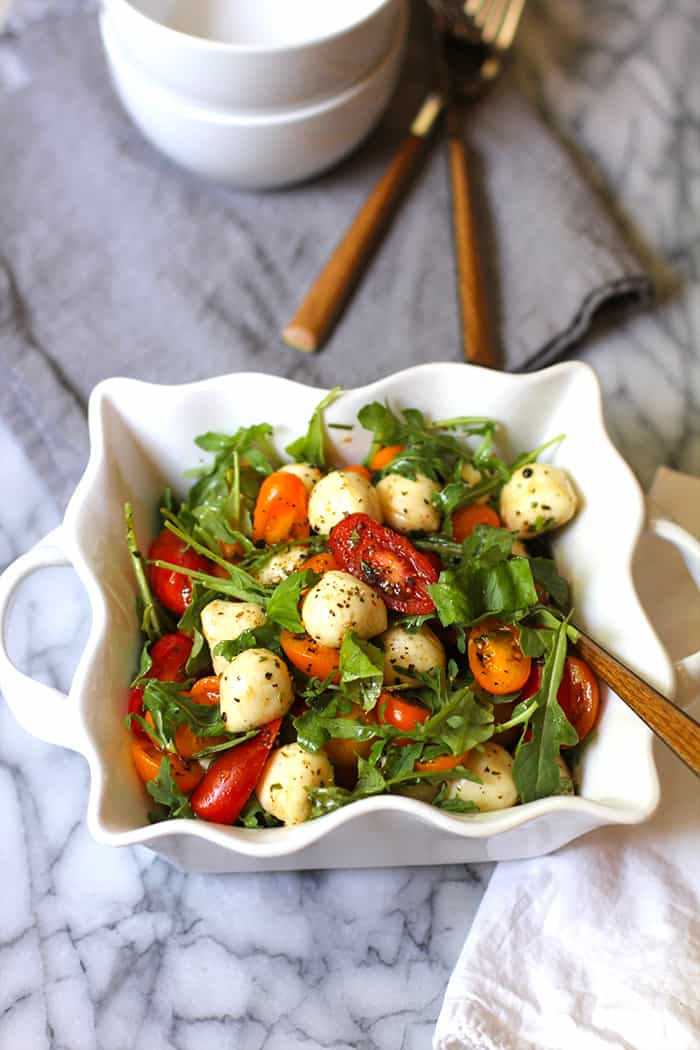 Arugula Caprese Salad is THE perfect 15-minute summer salad with fresh arugula, cherry tomatoes, basil, fresh mozzarella balls, and a balsamic dressing! | suebeehomemaker.com