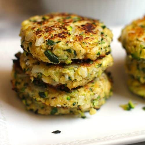 Side shot of a tray of stacked Grilled Italian Zucchini Fritters.