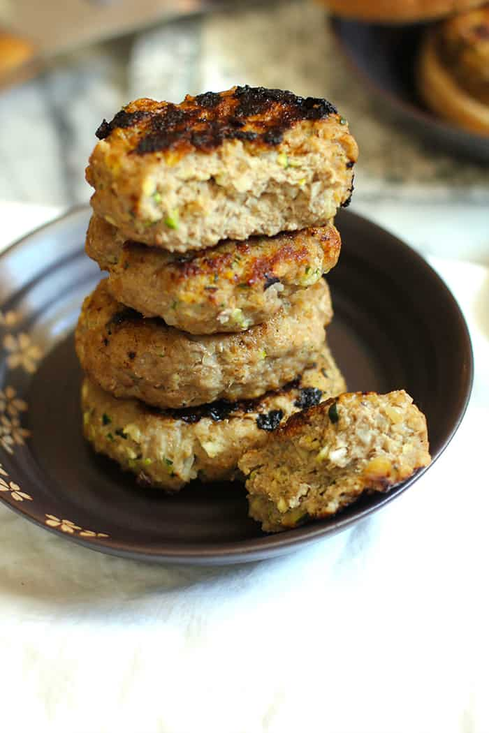 Grilled Zucchini Turkey Burgers combine lean ground turkey with grated zucchini and onion, bread crumbs, parmesan cheese, and seasonings! So good! | suebeehomemaker.com