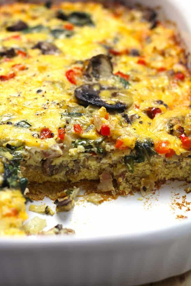 Side shot of a layer of omelette breakfast casserole.