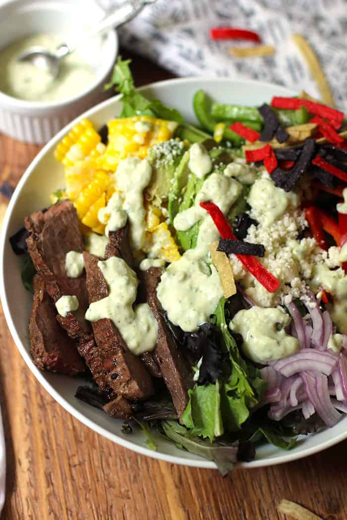 Flank Steak Fajita Salad is another Tex-Mex creation, combining a perfectly cooked flank steak, veggies, fresh corn - topped with Creamy Avocado Dressing! | suebeehomemaker.com