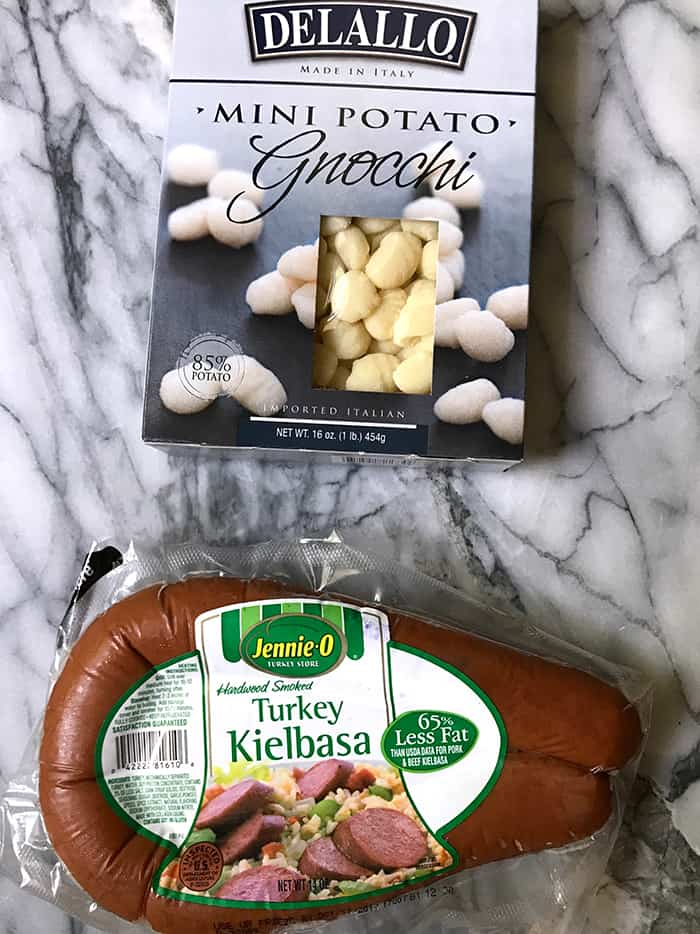 One Skillet Sausage Pesto Gnocchi is a quick meal, combining Jennie-O Turkey Sausage with mini potato dumplings, fresh spinach, and a tomato pesto mixture! | suebeehomemaker.com