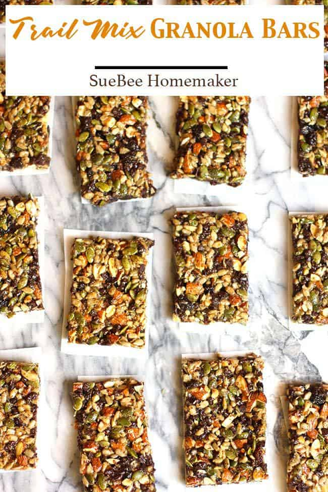 These Trail Mix Granola Bars combine all the salty, crunchy nuts, with raisins and chocolate chips - and are held together with a combination of brown rice syrup, almond meal, and peanut butter. So much better than store bought bars AND you know exactly what's in them! | suebeehomemaker.com | #trailmixbars #granolabars #granola #trailmix #snackbars