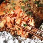Baked Asian Salmon in Foil is an easy weeknight dinner, but is impressive enough for guests on the weekend! Don't skip any of the Asian ingredients! | suebeehomemaker.com