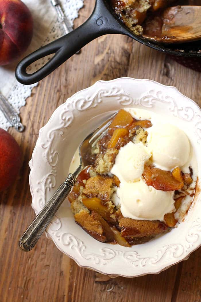 Skillet Peach Cobbler is a slightly sweet, but not-too-sweet Fall dessert that is AAAHHH-mazing with a couple scoops of vanilla ice cream. Eat it warm! | suebeehomemaker.com
