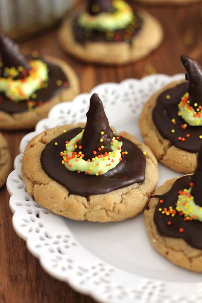 Witch Hat Peanut Butter Cookies will put a spell on your tricksters this Halloween! A simple peanut butter cookie all tricked up with a bugle and chocolate! | suebeehomemaker.com